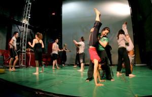Adults participate in a movement program at STREB SLAM.