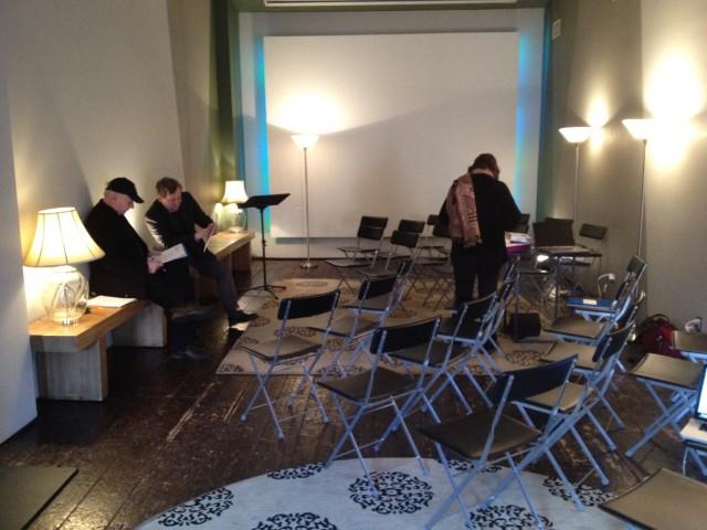 John McCann, Richard Evans, and Liz Dreyer of EmcArts prepare the room.