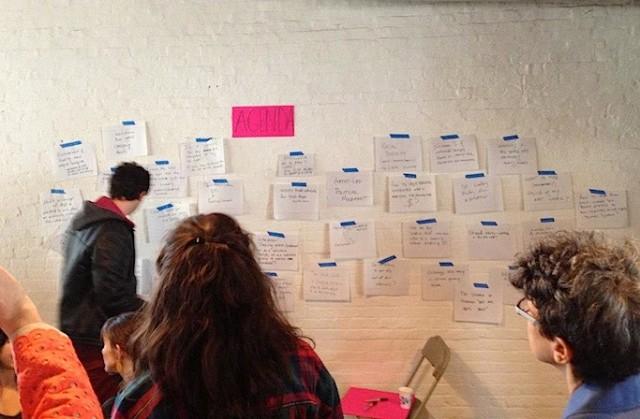 """An """"agenda wall"""" at a Culturebot event."""