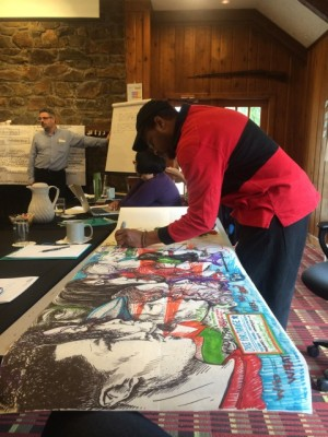 Ariston Jacks working on graphic interpretation during Alternate ROOTS's recent Innovation Lab retreat. Image: Alternate ROOTS.
